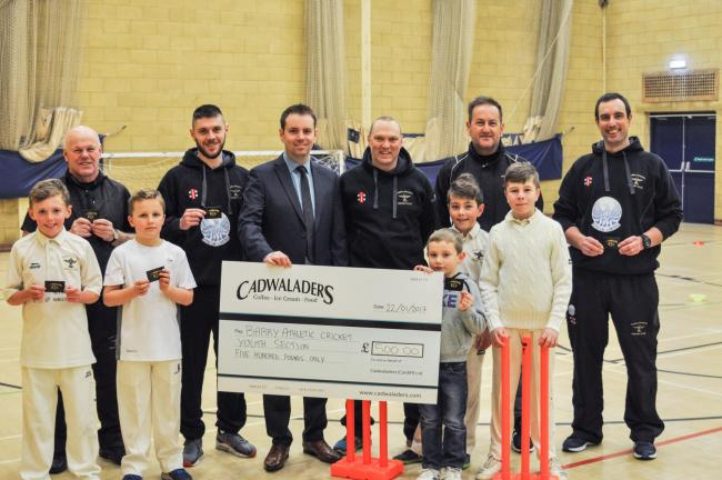 cadwaladers presenting cheque to barry athletic cricket club