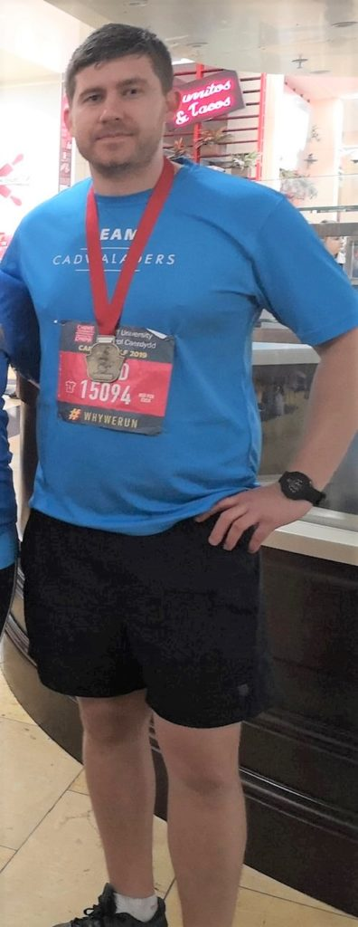 Aled with his Cardiff Half Marathon Medal